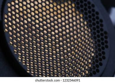 black honeycomb pattern on metal background