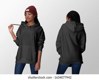 Black hoodie on a young african american woman in jeans and hat, front and back, isolated, mockup template