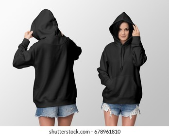 Black hoodie on a young woman in shorts, front and back, isolated, mockup.