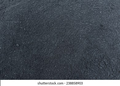 Black hot blacktop concrete on road surface not under compression yet