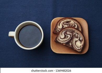 black hot coffee and marble chocolate pound cake isolated on tablecloth