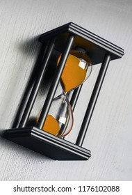 Black hourglass on black background. Close up