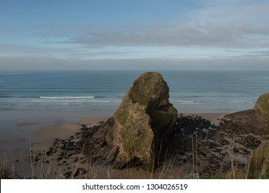 Black Humphrey Rock or Flory Island in the Middle of Whipsiderry Beach at Low Tide near the Popular Seaside Resort of Newquay in Rural Cornwall, England, UK