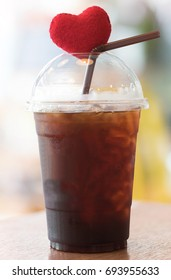Black ice coffee or Americano coffee with small heart in love, addict concept.