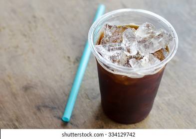 black ice coffee on wooden background
