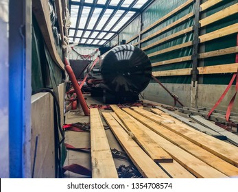 Black Industrial heat exchanger, tube shell and tube high efficiency. Transportation in the truck. Wooden planks.  For any purpose use.