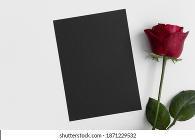 Black invitation card mockup with a red rose. 5x7 ratio, similar to A6, A5.