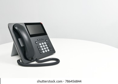 Black IP Phone, Office phone on the white table in the meeting room