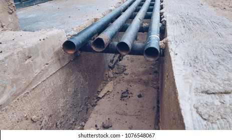 Black iron bars on a concrete drainage