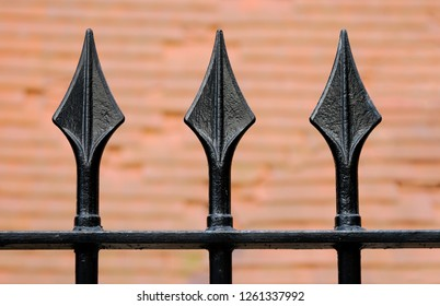 Black Iron fence with three spikes