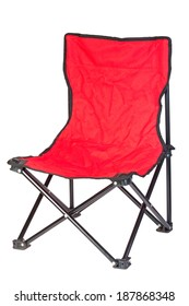 Black iron folding chair with red fabric on white background.