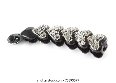 Black isolated barrette over white background. Fashion, object