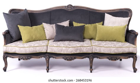 black and ivory sofa bed with black white and green pillows isolated on a white background
