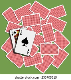 Black Jack Ace Spades blackjack hand playing card backs shuffled on casino table