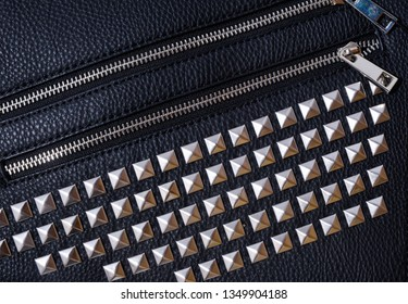 Black Jacket with Rivets leather texture background with seam
