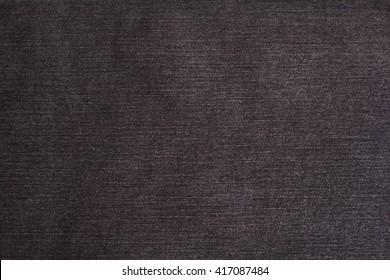 black jeans texture background closeup