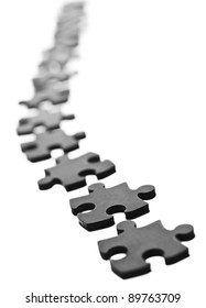 Black Jigsaw pieces in a row isolated on white