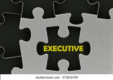 The black jigsaw puzzle written word executive.