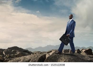 Black joyful businessman with briefcase