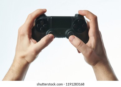 Black joystick in hands isolated on white background