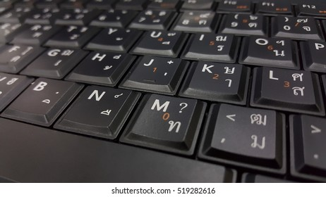 black keyboard with Thai alphabets