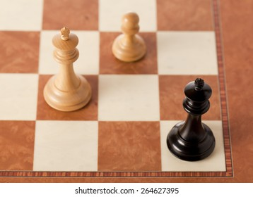 Black king in stalemate on a chessboard