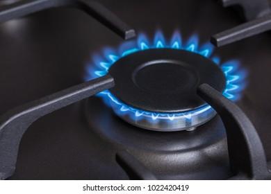 black kitchen gas stove burning burner close-up