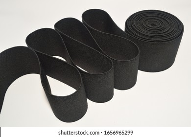 Black Knit Elastic Spool for needlework of the cloth insulated on white background.
