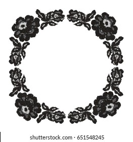 Black lace flowers in round frame on white background