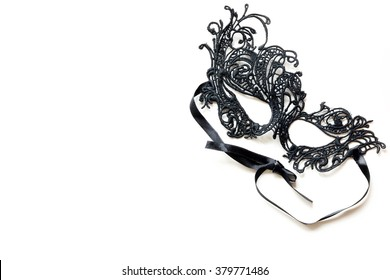 Black lace masquerade mask isolated on white background