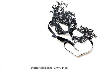 Black lace masquerade mask isolated on white background