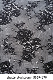 Black lace with pattern from flower on white background