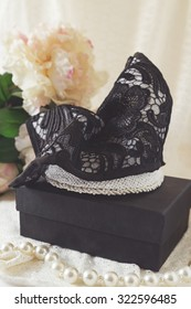 Black lace and pearl fascinator races hat with pearls