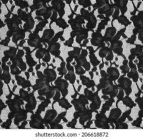Black lace texture with flowers on a white background