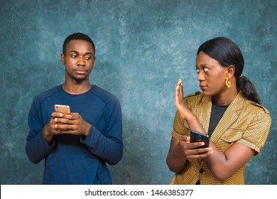 black lady stopping a man from spying at her phone