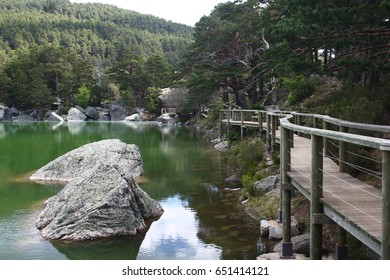 Black Lagoon of Picos de Urbión, Soria, Spain, Wooden path over water with railing