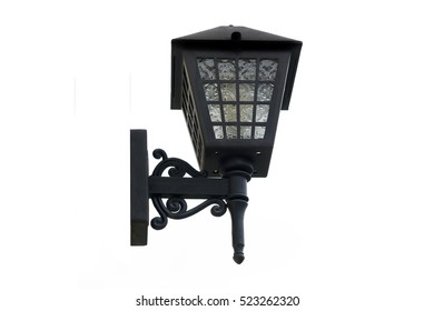 a black lamppost on white background. isolated lamp with electri