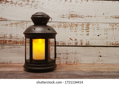 Black Lantern decorative with candles with space copy on wooden background