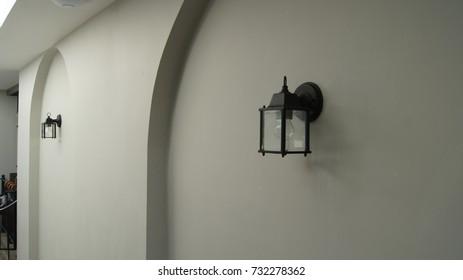 Black lantern on a white wall