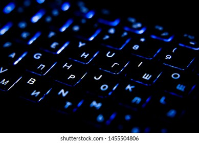 black laptop keyboard with backlight close-up