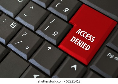 black laptop keyboard with a button the access denied