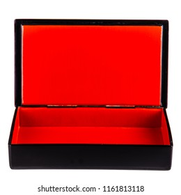 a black laquered box with a bright red interior isolated over white