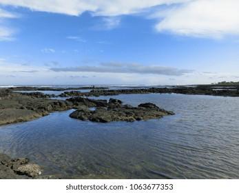 Black lava rock coastal tide pools