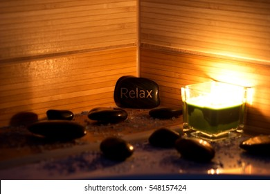 black lava stones massage, green candle and bath salt