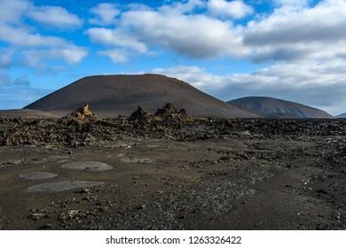 Black lava in the volcanic Timanfaya National Park, Lanzarote, Spain