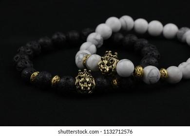 Black (lavastone) & White (marble) luxury beaded bracelets on a black background