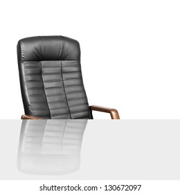 Black leather armchair with table. Business concept