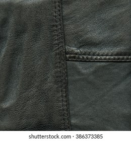 black  leather background decorated with seams