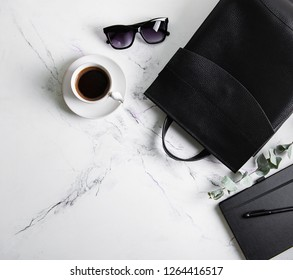 Black leather backpack on a marble background