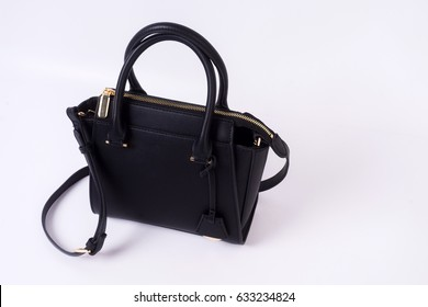 Black leather bag on white background